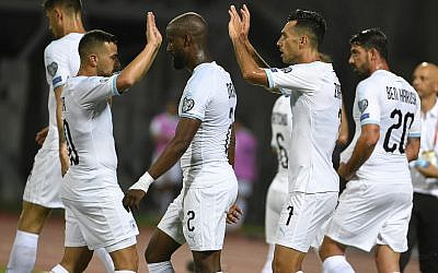 Eran Zahavi celebrates with teammates after he scored a goal during their Euro 2020 group G qualifying soccer match between Latvia and Israel in Riga, Latvia, June 7, 2019. (AP Photo/Roman Koksarov)