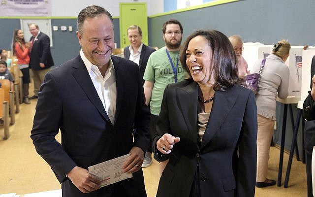 In this file photo from November 8, 2016, Kamala Harris, right, votes with her husband, Douglas Emhoff in Los Angeles. (AP Photo/Nick Ut, File)