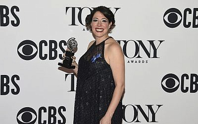 "Rachel Chavkin poses in the press room with the award for best direction of a musical for ""Hadestown"" at the 73rd annual Tony Awards on June 9, 2019, in New York. (Photo by Evan Agostini/Invision/AP)"