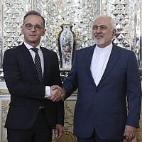 Iranian Foreign Minister Mohammad Javad Zarif, right, and his German counterpart Heiko Maas shake hands for media prior to their meeting, in Tehran, Iran on June 10, 2019. (AP Photo/Ebrahim Noroozi)