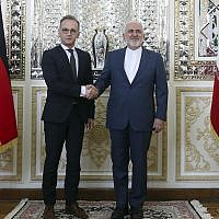Iranian Foreign Minister Mohammad Javad Zarif, right, and his German counterpart Heiko Maas shake hands for the media prior to their meeting, in Tehran, Iran, June 10, 2019. (Ebrahim Noroozi/AP)