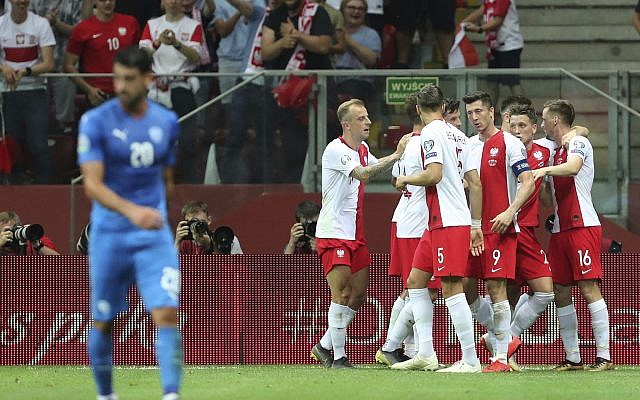 Poland's Krzysztof Piatek celebrates with teammates after scoring his side's opening goal during the Euro 2020 group G qualifying soccer match between Poland and Israel at the Narodowy stadium in Warsaw, Poland, June 10, 2019. (AP Photo/Czarek Sokolowski)