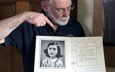 Ryan Cooper holds a 1972 portion of a diary that he wrote when he visited Otto Frank, the father of the famed Holocaust victim and diarist Anne Frank, at his home, on June 7, 2019. (AP Photo/Philip Marcelo)
