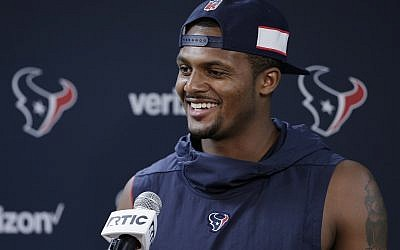 Houston Texans quarterback Deshaun Watson answers questions during a press conference after a practice at the team's NFL football training facility in Houston Tuesday, June 11, 2019. (AP Photo/Michael Wyke)