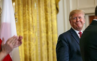 US President Donald Trump attends a Polish-American reception with Polish President Andrzej Duda in the East Room of the White House, Wednesday June 12, 2019. (AP Photo/Jacquelyn Martin)