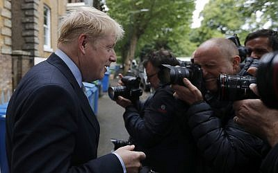 British Conservative Party lawmaker Boris Johnson leaves his home in London, June 13, 2019. (AP /Frank Augstein)