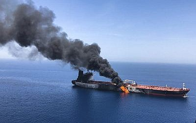 An oil tanker on fire in the Gulf of Oman, June 13, 2019 near the strategic Strait of Hormuz where two ships were reportedly attacked. (AP Photo/ISNA)