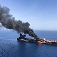 An oil tanker is on fire in the sea of Oman, June 13, 2019. (AP Photo/ISNA)