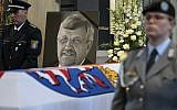 In this June 13, 2019 file photo a picture of Walter Luebcke stands behind his coffin during the funeral service in Kassel, Germany. (Swen Pfoertner/dpa via AP)