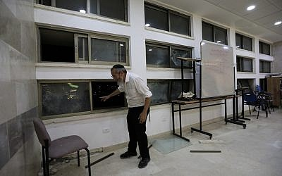 A rabbi stands inside a Jewish religious school in Sderot, Israel, after it was hit by a rocket fired from the Gaza Strip, Thursday, June 13, 2019. (AP/Tsafrir Abayov)