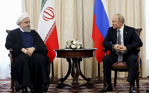 In this photo released on June 14, 2019, Russian President Vladimir Putin, right, and Iranian President Hassan Rouhani attend a meeting on the sideline of the Shanghai Cooperation Organization (SCO) summit, in Bishkek, Kyrgyzstan. (Iranian Presidency Office via AP)