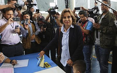 Sandra Torres, presidential candidate of the National Unity of Hope party, UNE, poses for photographers while casting her vote during general elections in Guatemala City, June 16, 2019.  (AP Photo/Oliver de Ros)