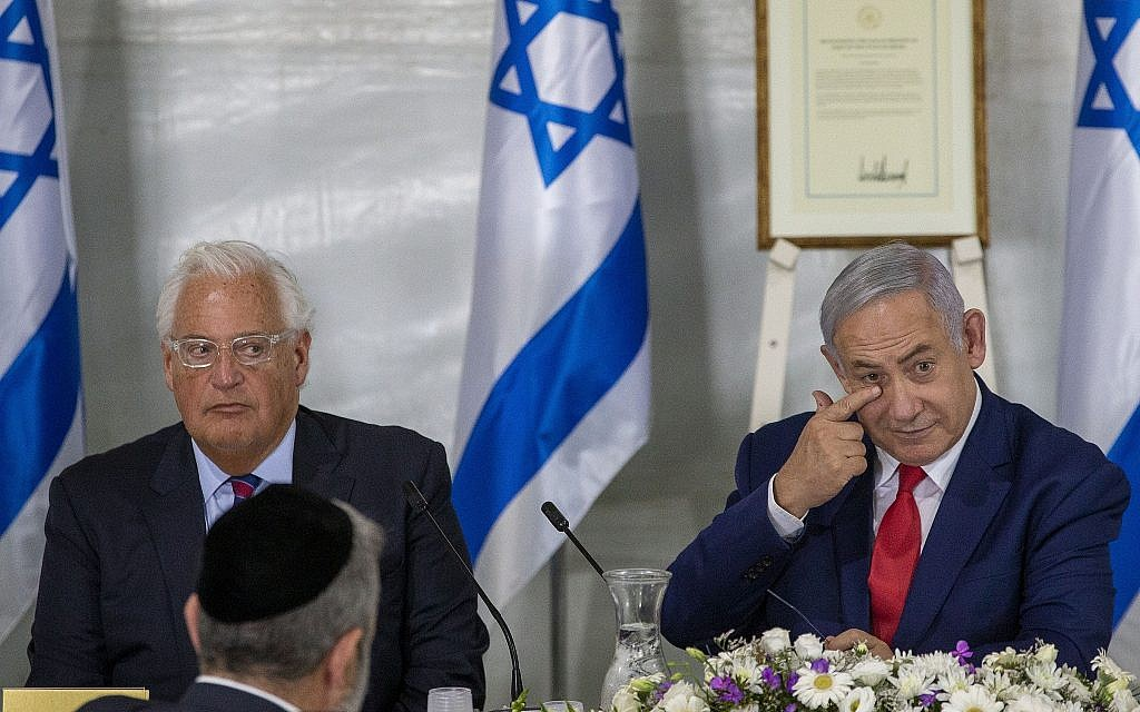 Israeli Prime Minister Benjamin Netanyahu convenes his cabinet with United States Ambassador to Israel David Friedman to inaugurate a new settlement named after US President Donald Trump in a gesture of appreciation for the US leader's recognition of Israeli sovereignty over the Golan Heights, June 16, 2019. (AP/Ariel Schalit)