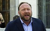 Conspiracy theorist Alex Jones speaks to reporters in Washington, Sept. 5, 2018. (AP/Jose Luis Magana, File)