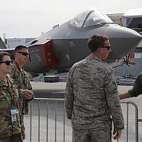 US Air Force crew members beside an F-35 Lightning II at the Paris Air Show June 18, 2019. (AP/Michel Euler)