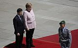 Ukrainian President Volodymyr Zelensky walks on the red carpet during a welcoming ceremony by German Chancellor Angela Merkel prior to a meeting at the chancellery in Berlin, Germany, June 18, 2019. (AP Photo/Markus Schreiber)