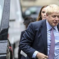 British Conservative party leadership contender Boris Johnson arrives for a live TV debate in central London Tuesday, June 18, 2019. (AP Photo/Vudi Xhymshiti)