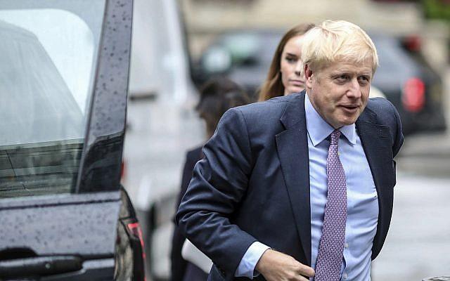 British Conservative party leadership contender Boris Johnson arrives for a live TV debate in central London Tuesday, June 18, 2019. (AP Photo/Vudi Xhymshiti)