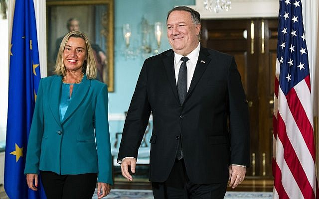 US Secretary of State Mike Pompeo walks with European Union High Representative Federica Mogherini, left, to the Treaty Room at the State Department in Washington, June 18, 2019. (AP Photo/Manuel Balce Ceneta)