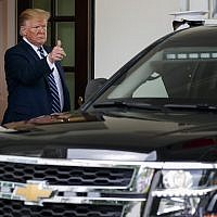 President Donald Trump makes the thumbs up sign to Canadian Prime Minister Justin Trudeau as he leaves the West Wing of the White House, Thursday June 20, 2019, after their meeting in Washington. (AP Photo/Jacquelyn Martin)