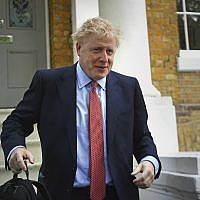 Britain's former Foreign Secretary Boris Johnson leaves his home in London, Friday June 21, 2019. Boris Johnson and Jeremy Hunt will battle to become the new leader of the Conservative party, and the next prime minister, as the Tory leadership contest moves to a ballot of the 160,000 Conservative members. (Kirsty O'Connor/PA via AP)