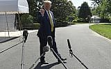 US President Donald Trump speaks to reporters on the South Lawn of the White House in Washington, Saturday, June 22, 2019, before boarding Marine One for the trip to Camp David in Maryland. (AP Photo/Susan Walsh)