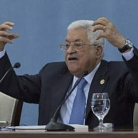 Palestinian President Mahmoud Abbas talks to reporters at the Palestinian Authority headquarters, in the West Bank city of Ramallah on June. 23, 2019. (AP/Nasser Nasser)