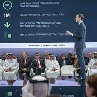 "US Treasury Secretary Steven Mnuchin, fifth from left, and Bahrain Crown Prince Salman bin Hamad Al Khalifa, sixth from left, listen to White House senior adviser Jared Kushner, standing, during the opening session of the ""Peace to Prosperity"" workshop in Manama, Bahrain on June 25, 2019. (Bahrain News Agency via AP)"