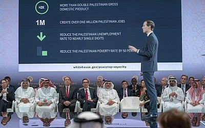 "In this June 25, 2019, photo released by Bahrain News Agency, US Treasury Secretary Steven Mnuchin, fifth from left, and Bahrain Crown Prince Salman bin Hamad Al Khalifa, sixth from left, listen to White House senior adviser Jared Kushner, standing, during the opening session of the ""Peace to Prosperity"" workshop in Manama, Bahrain (Bahrain News Agency via AP)"