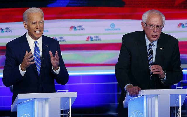 Democratic presidential candidates former US vice president Joe Biden and Independent Senator Bernie Sanders of Vermont speak at the same time during the Democratic primary debate hosted by NBC News at the Adrienne Arsht Center for the Performing Arts, June 27, 2019, in Miami. (AP Photo/Wilfredo Lee)