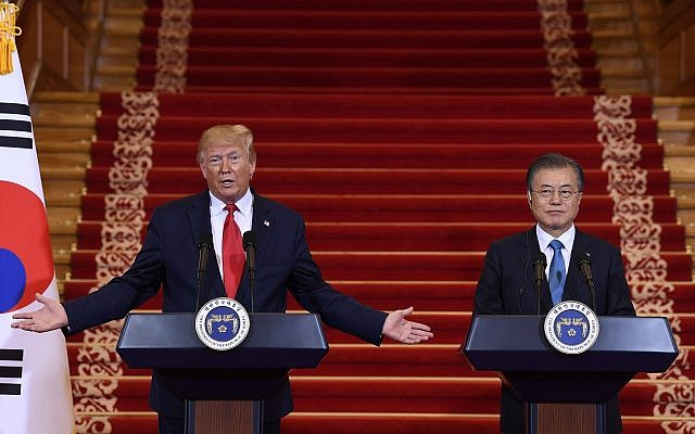 Trump crosses inter-Korean border as 1st sitting U.S. president