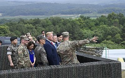 US President Donald Trump views North Korea from the Korean Demilitarized Zone from Observation Post Ouellette at Camp Bonifas in South Korea, June 30, 2019. (AP Photo/Susan Walsh)