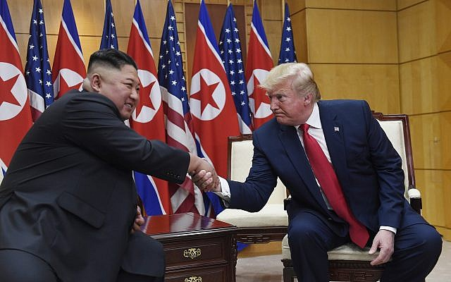 US President Donald Trump (right) meets with North Korean leader Kim Jong Un at the border village of Panmunjom in the Demilitarized Zone, South Korea, June 30, 2019. (AP Photo/Susan Walsh)