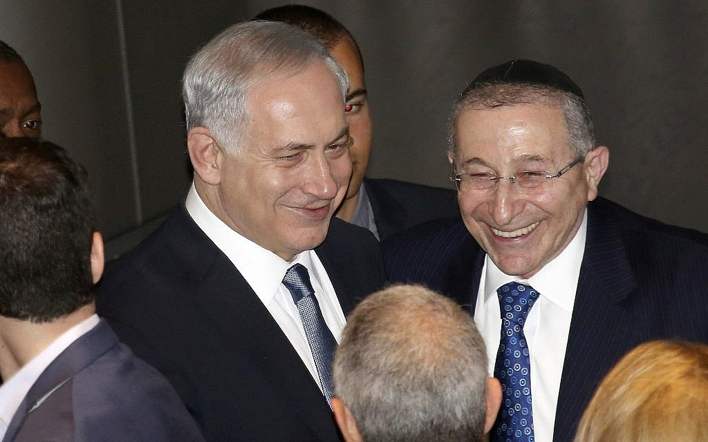 Israeli Prime Minister Benjamin Netanyahu, left, and Wiesenthal Center founder and dean Rabbi Marvin Hier greet leaders in Los Angeles's Jewish community at the Simon Wiesenthal Center's Museum of Tolerance, Thursday, March 6, 2014, in Los Angeles.  (AP Photo/Nick Ut)