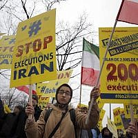 Supporters of Maryam Rajavi, President of the National Council of Resistance of Iran, demonstrate against Iranian President Hassan Rouhani's visit in Paris, Wednesday, Jan. 27, 2016. Banner on the right reads 'Human rights. No complaisance. 2000 executions after 2 years with Rouhani.' (AP Photo/Christophe Ena)
