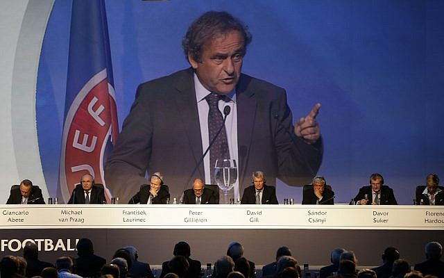 Former UEFA President Michel Platini is seen on a giant screen as he delivers a speech at a UEFA meeting in Athens, on September 14, 2016. (AP/Thanassis Stavrakis)