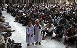 Illustrative - Muslims attend the Friday noon prayer at Al-Azhar mosque in Cairo, Egypt, December 28, 2012. (AP/Khalil Hamra)