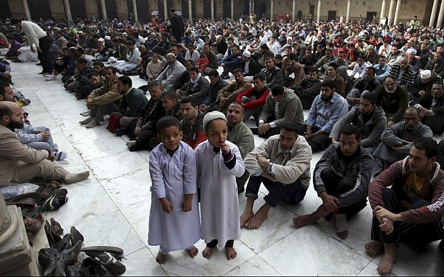 Illustrative - Muslims attend the Friday noon prayer at Al-Azhar mosque in Cairo, Egypt, December 28, 2012. (AP/Khalil Hamra)
