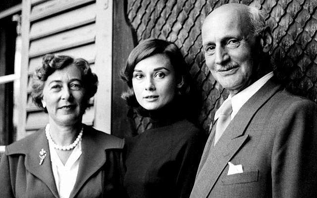 In 1957, the stress of a day in Switzerland with Elfriede and Otto Frank is visible on Audrey Hepburn's face. He had asked her to portray his daughter Anne Frank in an upcoming film; she will tell him that, for a variety of reasons, she can't. (Eva Schloss, photographer; Anne Frank House)