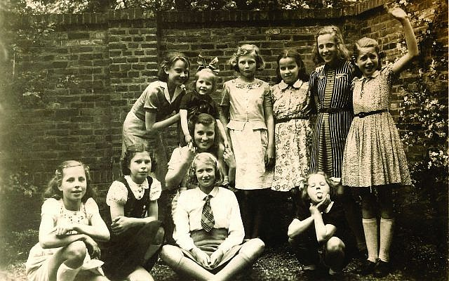 In Arnhem on May 8, 1942, four days after her Uncle Otto's arrest, Audrey Hepburn (standing, left) holds Annelies Bouma at a birthday party for sister Hilda (striped dress), who is Audrey's classmate from the Middelbare Meisjes School and dance mate at ballet school. A third Bouma sister, Maya, sticks out her tongue at the camera. (Van Rossem-Bouma Family Collection)