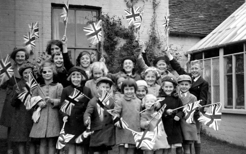Near the end of her stay in Elham, Audrey Hepburn (fourth from left) waves the Union Jack. (Dotti Collection)