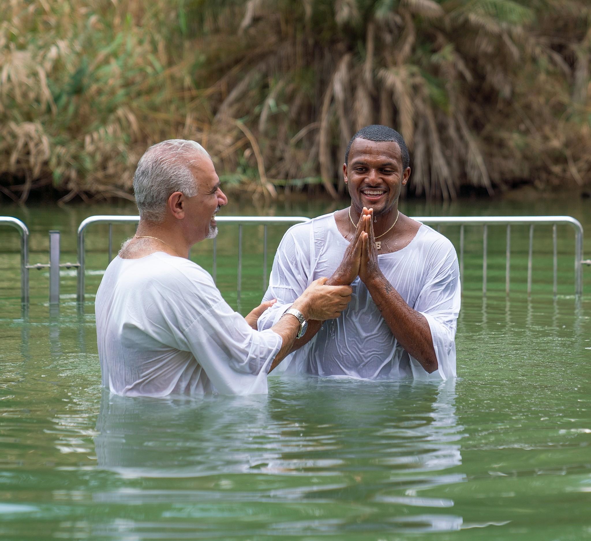 58bafe29980 Houston Texans all-star quarterback Deshaun Watson (right) getting baptized  in the Jordan