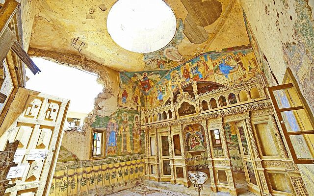 Ornate and colorful frescoes are mostly intact despite the decades of neglect in the Romanian Monastery, the last church building in the Land of the Monasteries to be cleared of landmines, in a photo released by the Ministry of Defense on June 20, 2019. (courtesy Ministry of Defense)