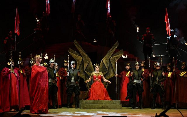 Queen Abigaille assumes the throne as part of Verdi's Nabucco opera, performed at Jerusalem's Sultan's Pool venue on June 20, 2019. (Eithan Elkin)