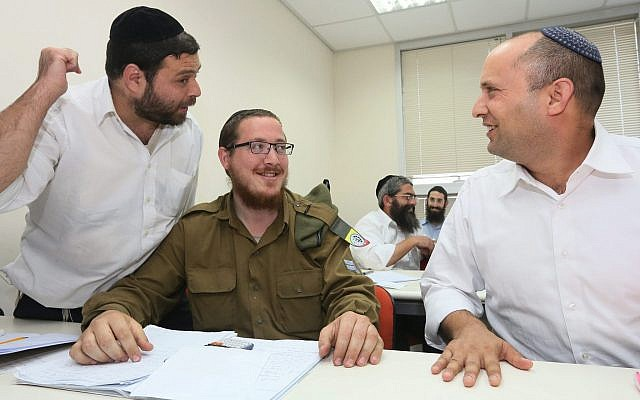 Then-economics minister Naftali Bennett visits a center in the central Israeli city of Bnei Brak where religious men and women are trained in math, English and other core subjects not taught in ultra-Orthodox schools and seminaries, on April 2015, 2013. (Assaf Shilo/Economy Minister/Flash90)