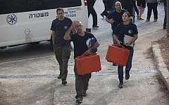 Illustrative: Crime scene investigators in Jerusalem on November 24, 2013. (Yonatan Sindel/FLASH90)