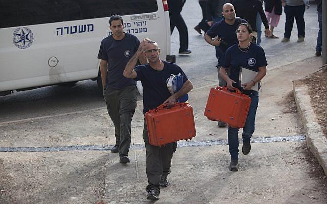 Illustrative: Crime scene investigators in Jerusalem on November 24, 2013. (Yonatan Sindel/FLASH90)