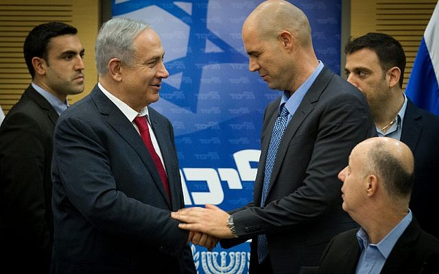 Prime Minister Benjamin Netanyahu (L) seen with MK Amir Ohana at a Likud party meeting in the Knesset on January 11, 2016. (Miriam Alster/Flash90)