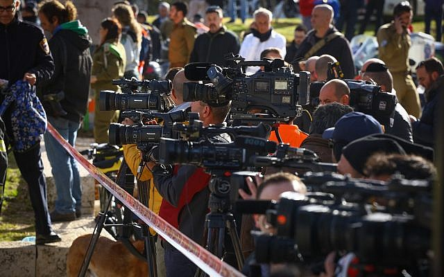 Illustrative: Israeli and foreign media at the scene of a Jerusalem terror attack on January 8, 2017. (Shlomi Cohen/Flash90)