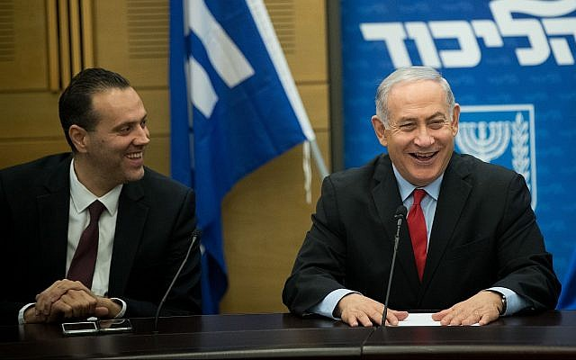 Prime Minister Benjamin Netanyahu (R) with Likud MK Miki Zohar at a Likud faction meeting in the Knesset on February 26, 2018. (Yonatan Sindel/Flash90)